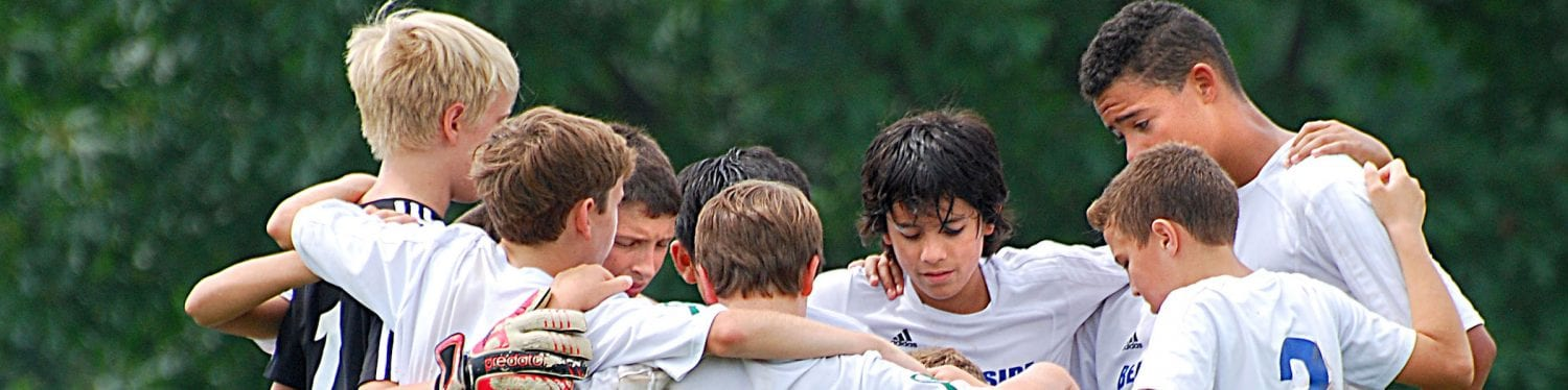 Boys Soccer Team Huddle